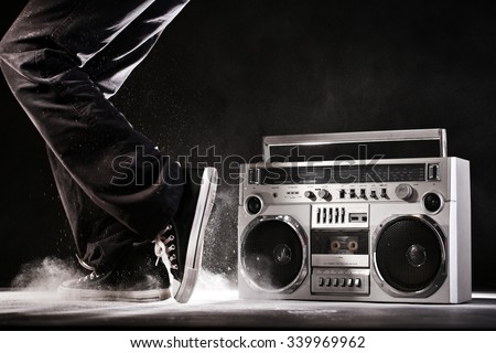 Retro ghetto blaster, dust and dancer isolated on black background with clipping path - stock photo