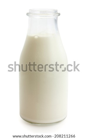 Retro glass bottle of fresh milk. With clipping path. - stock photo