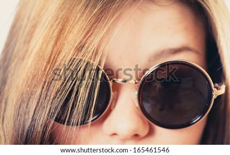retro glasses closeup shot, vintage toned image - stock photo