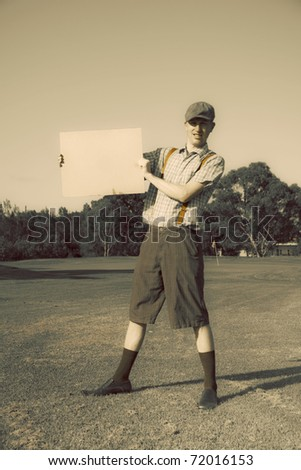 Retro Golf Player Sends Out A Message By Holding Up A Rustic Banner In A Sepia Toned Sports Portrait