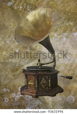 retro gramophone in a vintage background - stock photo