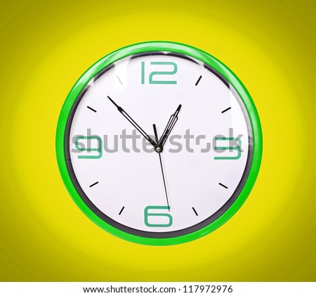 Retro green clock on yellow background