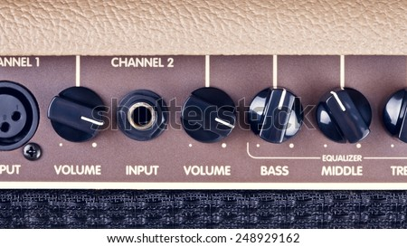 retro guitar amplifier control panel with knobs - stock photo