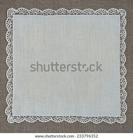 retro handkerchief with thread lace on linen - stock photo