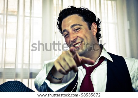 Retro - handsome man laughing pointing at camera