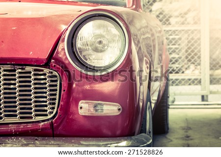 Retro headlight of vintage car - stock photo