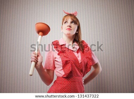 Retro housewife with tool to clean toilette