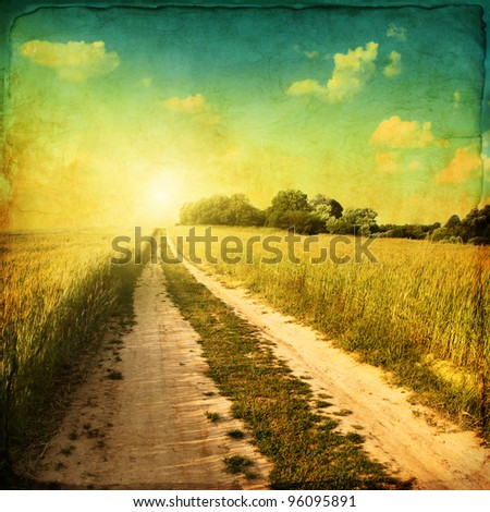 Retro image of country road at sunset. - stock photo