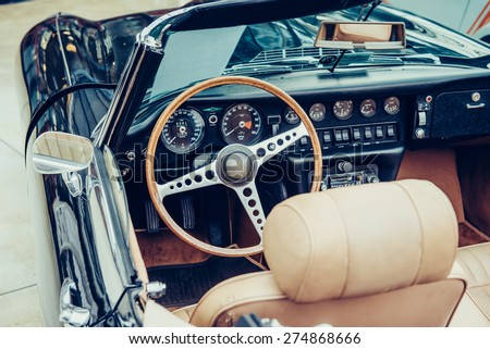 Retro interior of old automobile - stock photo
