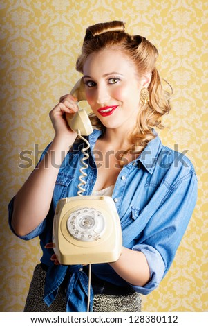 Retro Lady Wearing Denim Shirt And Leopard Print Skirt Chatting On The Home Phone Against Yellow Wallpaper Background - stock photo