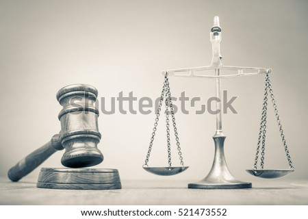 Retro law scales and wooden gavel on table. Symbol of justice. Vintage style sepia photo
