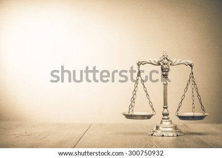 Retro law scales on table. Symbol of justice. Vintage style sepia photo - stock photo