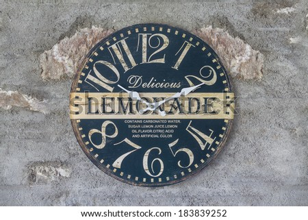 Retro Lemonade Themed Wall Clock on Wall - stock photo