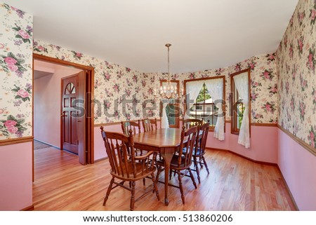 Retro look of dining room with wooden carved table set and hardwood floor. Northwest, USA