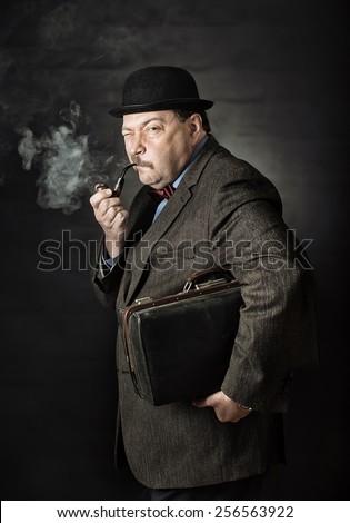 Retro man smoking a pipe - stock photo