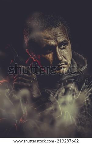 Retro man with a gun ready to shoot - stock photo