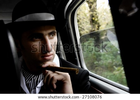 retro man with cigar in the car