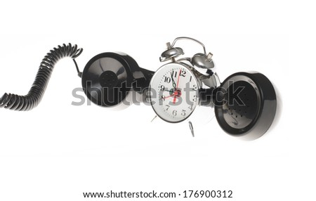 Retro metal alarm clock and black Handset of old telephone isolated on white background - stock photo