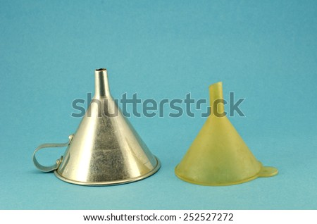retro metal and plastic funnel hopper tool on blue background - stock photo