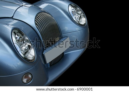 Retro metallic blue sportscar on a black background - stock photo