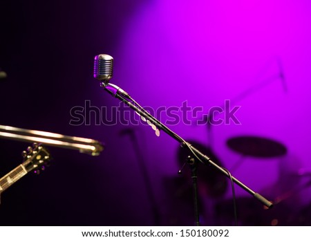 Retro microphone in stage lights