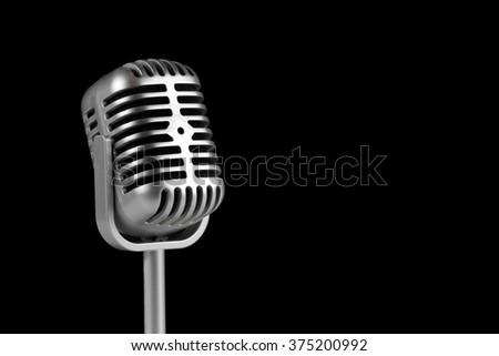 Retro microphone on black background.