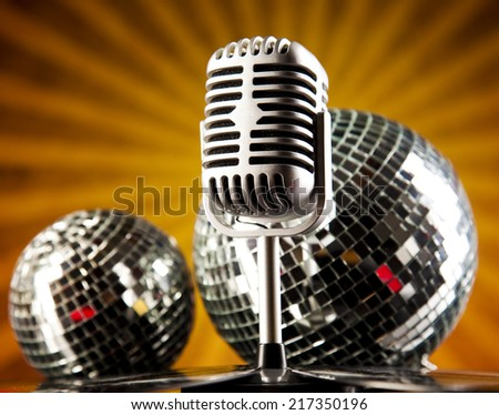 Retro microphone on sun grunge   - stock photo