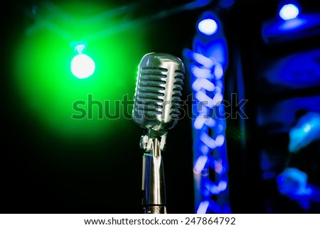 Retro microphone on the stage - stock photo
