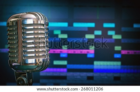 Retro microphone over recording software background. - stock photo