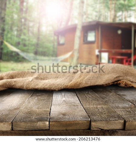 retro napkin on table in forest and camping space  - stock photo