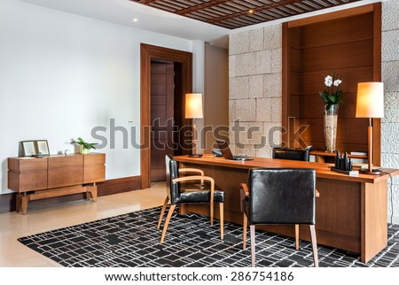 retro office room interior with desk and armchair - stock photo