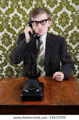 Retro office worker angry on the phone - stock photo