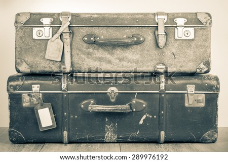 Retro old classic big travel leather valises. Vintage style sepia photo - stock photo