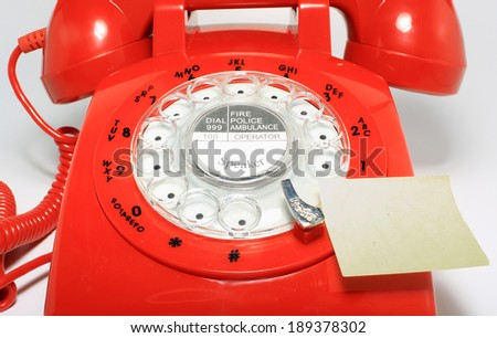 retro old fashion rotary dial phone close up with memo  - stock photo