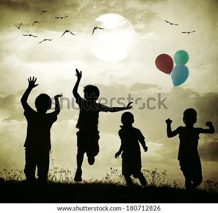 Retro old fashioned photo of children with balloons running on summer meadow - stock photo