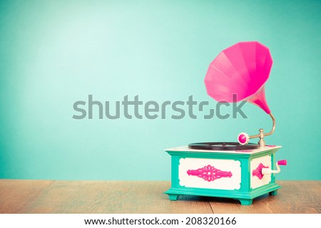 Retro old gramophone radio receiver front mint green background - stock photo