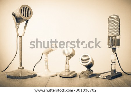 Retro old microphones for press conference or interview. Vintage style sepia photo - stock photo