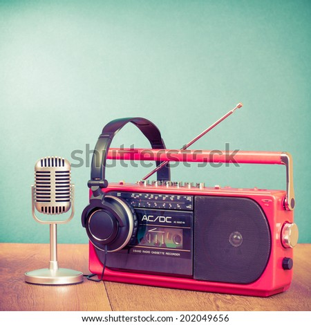 Retro old radio cassette recorder, plastic microphone and headphones - stock photo