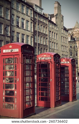 Retro old red telephone booths on Royal mile street in Edinburgh, capital of Scotland, United Kingdom - stock photo