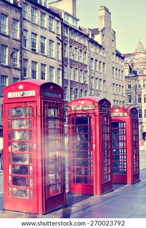 Retro old red telephone booths on Royal mile street in Edinburgh, capital of Scotland, United Kingdom. Vintage style photograph - stock photo