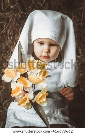 Retro! One year smiling baby dressed in Second World War nurse russian uniform. Hay background. - stock photo