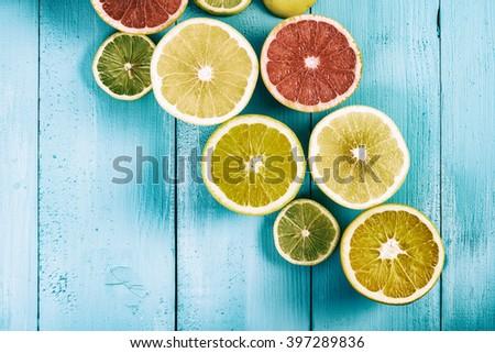 Retro Orange, Grapefruit And Lemon Citrus Fruit Slices - stock photo