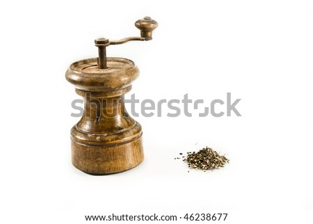 Retro pepper-grinder isolated on white background