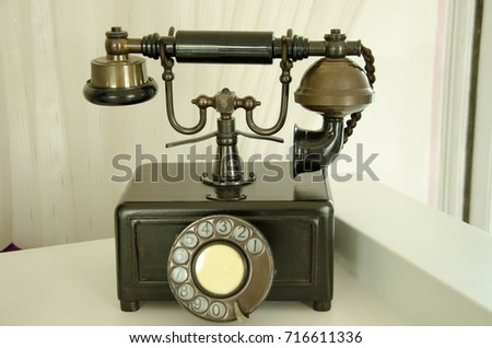 Retro Phone model vintage old dial Telephone on white background.
