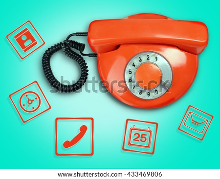 Retro phone with icons on blue background - stock photo