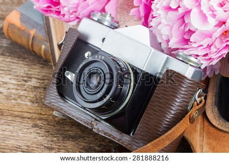 retro  photo camera with books and peony flowers - stock photo