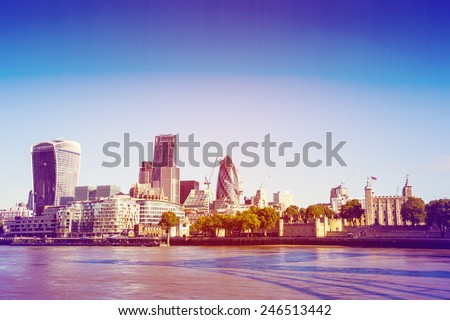 Retro Photo Effect - City of London, one of the leading centers of global finance, viewed from the South Bank across the River Thames. - stock photo