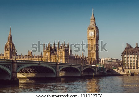 Retro Photo Effect - Elizabeth Tower, Big Ben and Westminster Bridge in early morning light, London, England, UK - stock photo
