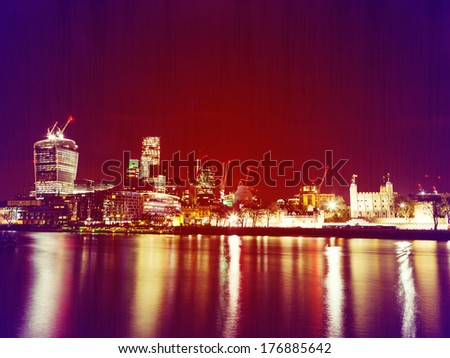 Retro Photo Filter Effect City of London at Night, one of the leading centers of global finance.View includes Tower 42 Gherkin,Willis Building, Stock Exchange Tower Lloyd`s of London and Walkie Talkie - stock photo