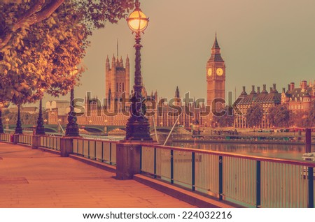 Retro Photo Filter Processed Effect - Street Lamp on South Bank of River Thames with Big Ben and Palace of Westminster in Background, London, England, UK - stock photo